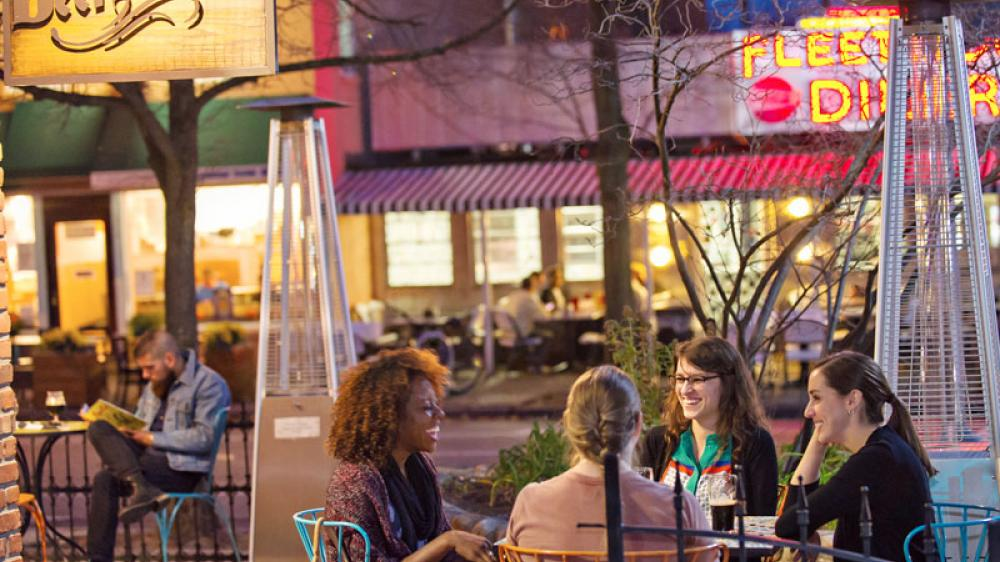 Friends laugh together at the Beer Grotto in downtown Ann Arbor
