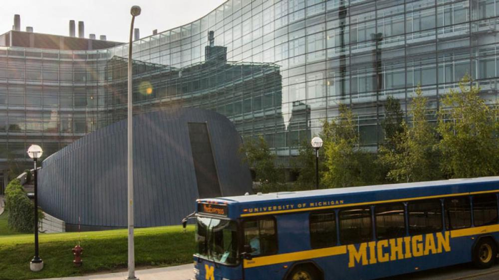 A Michigan blue bus passes the Biomedical Science Research Building