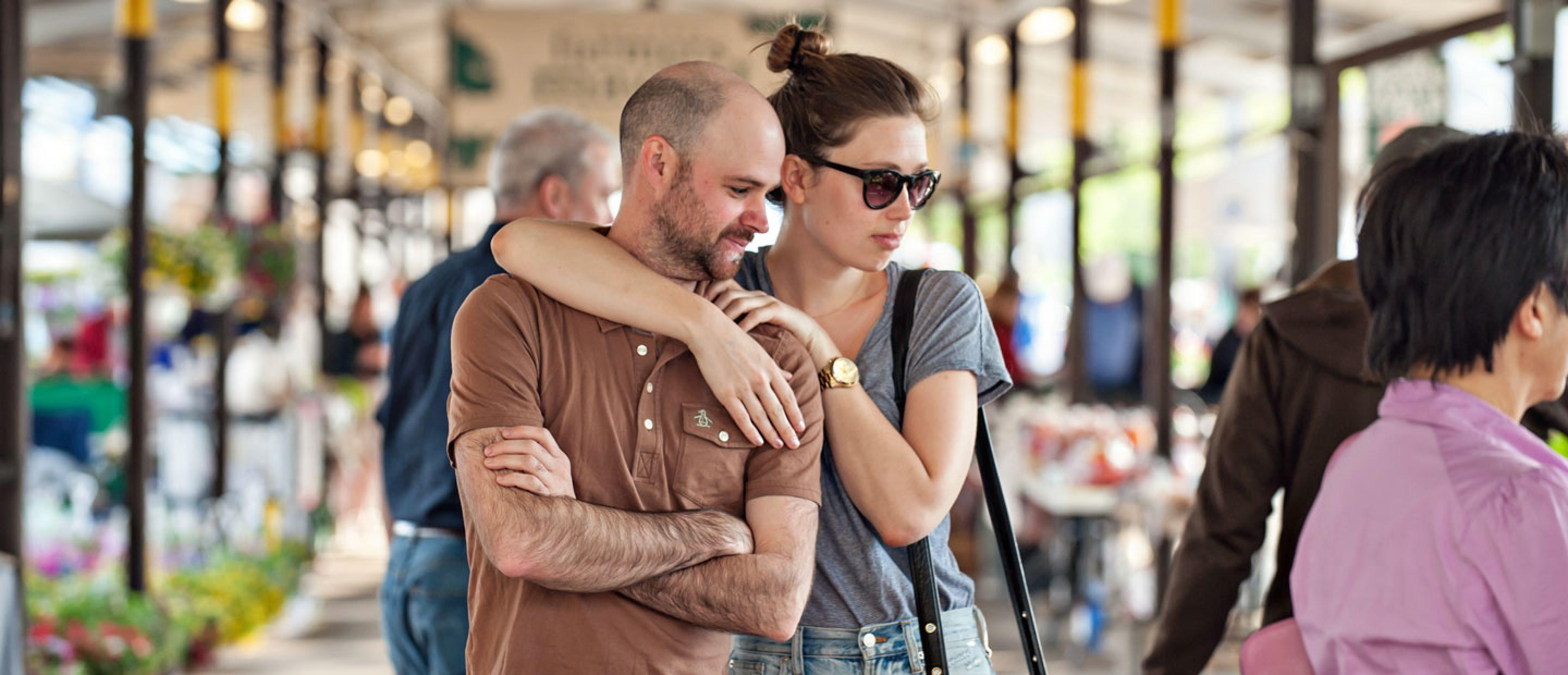 A couple browses the Ann Arbor Farmers Market