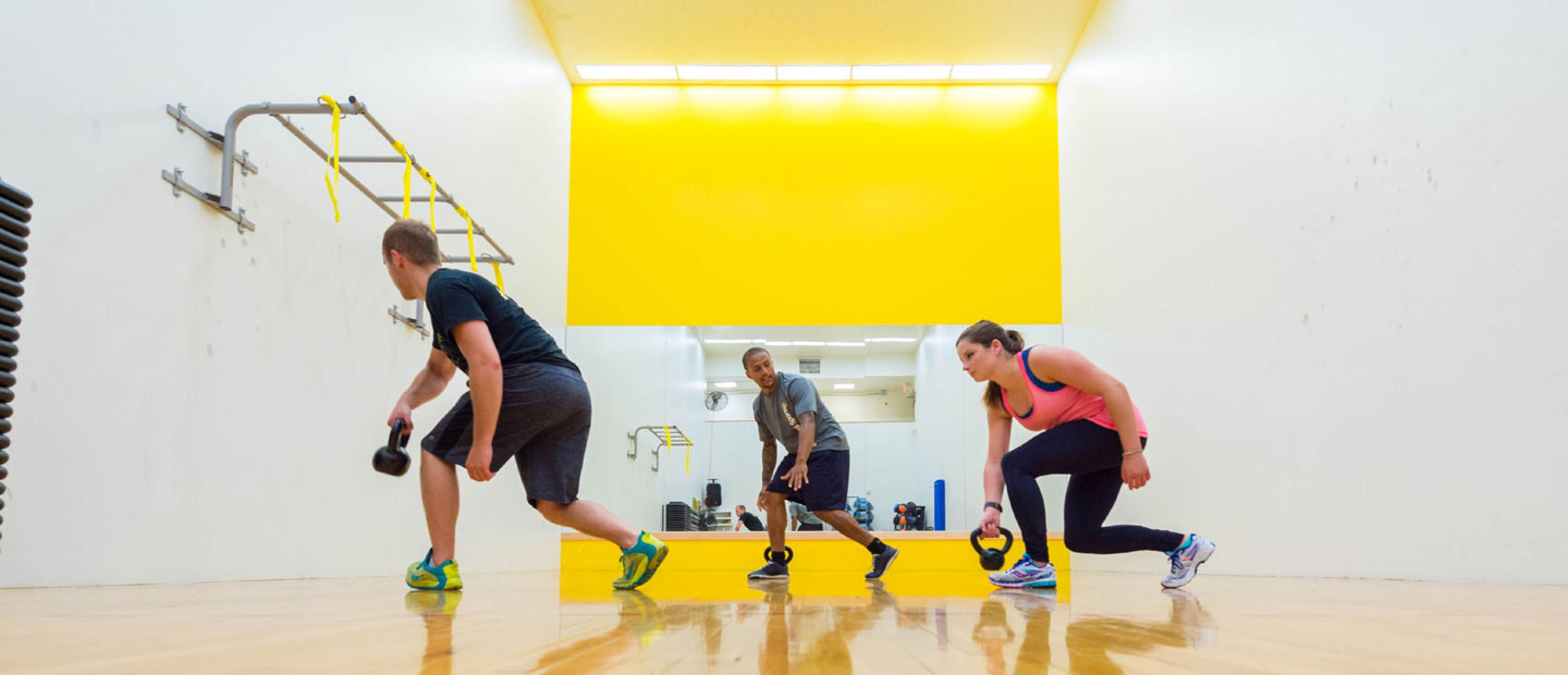 Participants in a kettlebell fitness class