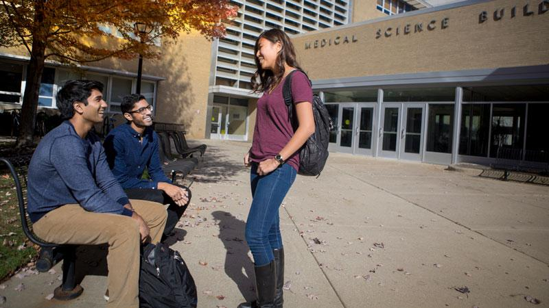 Students hang out and talk outside the Medical Science building